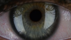Human pupil widens and narrows, with opening and closing the lid. macro Stock Footage