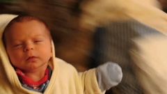 World spinning around newborn baby - entertainment on father's hands Stock Footage