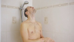 Man washing hair with shampoo in the shower. bathroom. Stock Footage