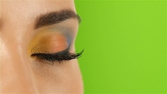 Girl with bright beautiful make up, visagiste artist shows his professionalism Stock Footage