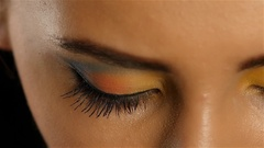 Girl with gray eyes with beautiful make up looks fascinating look into the Stock Footage