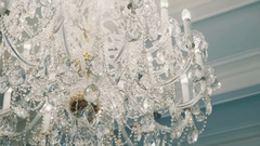Close up tracking shot expensive old style glass diamonds chandelier Stock Footage