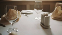 Dolly shot close up beautifully served table in restaurant warm tones Stock Footage