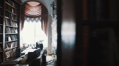 Tracking shot old style archive interior. Bookshelves. curtains, printer Stock Footage
