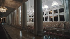 Moving shot interior of empty bright large concerte hall. Big white pillars Stock Footage