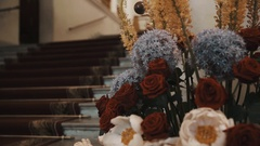 Staircase with carpet, old classical conert hall hallway, roses on foreground Stock Footage