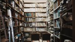 Lights turns on in old style library interior. Stepladder, books and folders Stock Footage