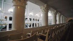 Tracking shot balcony of large classic style organ hall. Big glass chandeliers Stock Footage