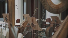 Close up harp string, music stands and cello on background focus pull Stock Footage