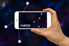 Augmented Reality, AR, of Cancer Zodiac Constellation App on Smartphone Scr.. Stock Photos