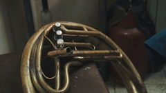 Close up shot part of brass tuba with three white perl buttons Stock Footage