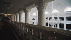 Tracking shot balcony of large classic style concert hall. Big glass chandeliers Stock Footage