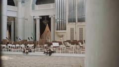 Dolly shot interior empty classic style organ hall. Big glass chandeliers Stock Footage