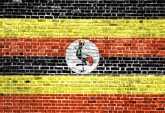 Flag of Uganda painted on brick wall, background texture Stock Photos