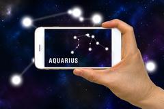 Augmented Reality, AR, of Aquarius Zodiac Constellation App on Smartphone S.. Stock Photos