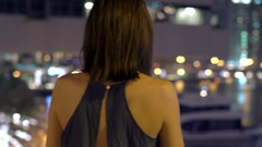 Young woman admire cityscape and river at night Stock Footage