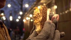 Man eating Doner Kebab at the night street lights - close up Stock Footage