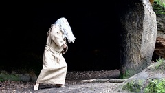 Bearded hermit in sackcloths dancing in a cave Stock Footage