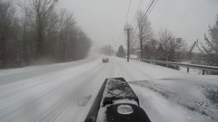 Cartop clip of driving in a snowstorm on a wintry New England Day Stock Footage
