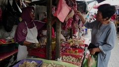 Woman buys the meat in the food market in Jakarta, Indonesia. Stock Footage