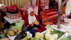 Woman cleans pineapple in the food market in Jakarta, Indonesia. Stock Footage