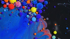 Stream Of Colorful Bubbles Moving On Paint Surface Black Blue Yellow Ink Stock Footage
