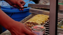 Grilled sausages on the food market in Jakarta, Indonesia. Stock Footage