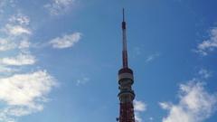 Tokyo tower landmark architect behind zojoji temple in bright summer sky Stock Footage