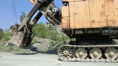 Track excavator moving on the career road Stock Footage