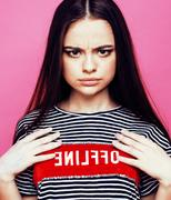 Young pretty teenage woman emotional posing on pink background, fashion Stock Photos