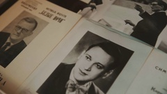 Dolly shot close up old russian classical concert handbills and photographs Stock Footage