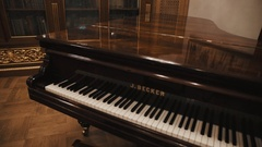 Dolly shot of expensive looking grand piano in old classical interior Stock Footage