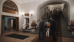 People in old classical concert hall interior with carpet on staircase Stock Footage