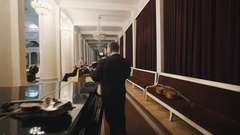 Behind the scene musicians preparing for a concert on scene of big concert hall Stock Footage