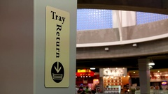 Motion of tray return sign at food court area inside mall with 4k resolution. Stock Footage