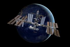 International Space Station over the planet Earth. Stock Photos