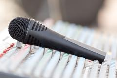 Concert music control with microphone Stock Photos