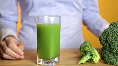 Green smoothie woman drinking healthy organic vegetable juice breakfast Stock Footage