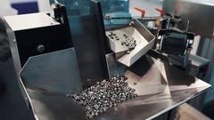 Conveyor industrial machine producing steel internal screws Stock Footage