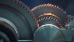 Metal cogwheel gears turning inside of working machine Stock Footage