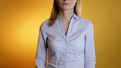 Slim model in jeans with a stomach ache on a yellow background Stock Footage