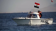 Maritime Coast Guard is moving on a motor boat with the Egyptian flag on the Red Stock Footage