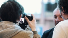 Russian actor Nikolai Fomenko interviewed by journalists in business hall Stock Footage
