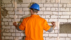 Young constructor working With Level Stock Footage