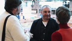 Russian musician Nikolai Fomenko interviewed by journalists in business hall Stock Footage