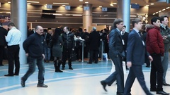 People crowd gather in bright business center hall for event Stock Footage