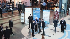 People crowd walking through checkpoint at business innovations exposition Stock Footage