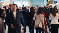 People crowd walking in halls at business or politic exposition event Stock Footage