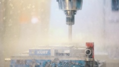 Working behind glass automatic machine drill produce lot of water splashes Stock Footage