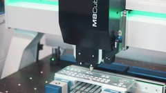 Precise automatic machine cut metal mold of keyboard at exhibition Stock Footage